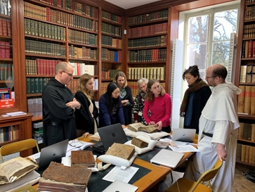 Workshop participants examine medieval documents and liturgical manuscripts held in Provins (photograph by Jeffrey Wayno, 2019)