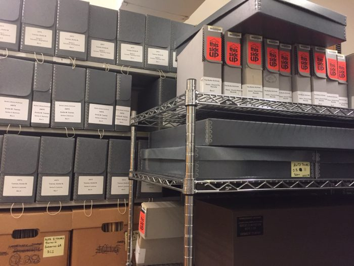 Archive storage boxes on a wire cart in the Burke Library