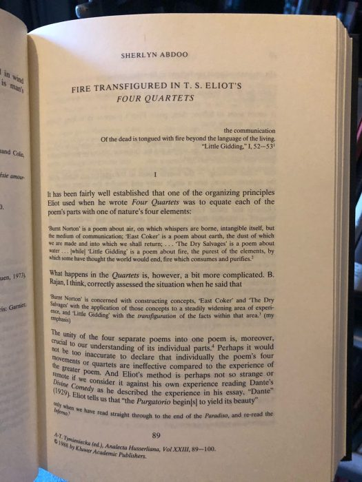 """Photo of a book page, chapter by Sherlyn Abdoo titled, """"Fire Transfigured in T.S. Eliot's Four Quartets,"""" beginning with the line from Eliot, """"the communication / Of the dead is tongued with fire beyond the language of the living"""" (from """"Little Gidding"""")"""