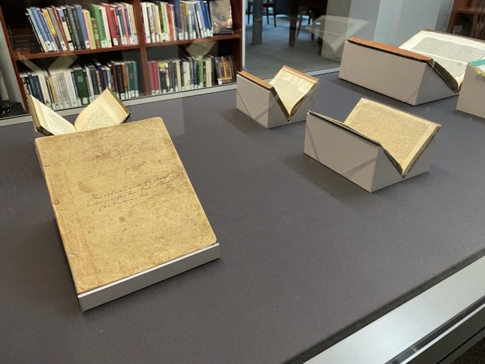 New Exhibit in the Seth Kasten Memorial Exhibit Case (Fall 2021) -- visible are several open books and a yellowed manuscript page with the text illegible
