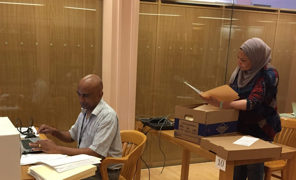 Rajendran T. Govender of the Kwazulu-Natal Department of Arts and Culture, South Africa, and Nagah Sayed-Ahmed, an independent social science researcher and activist from Egypt, consult the paper records of the Ford IFP Archive in the reading room at the Rare Book and Manuscript Library.