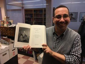 Robb Haberman shows volume five of John Jay papers