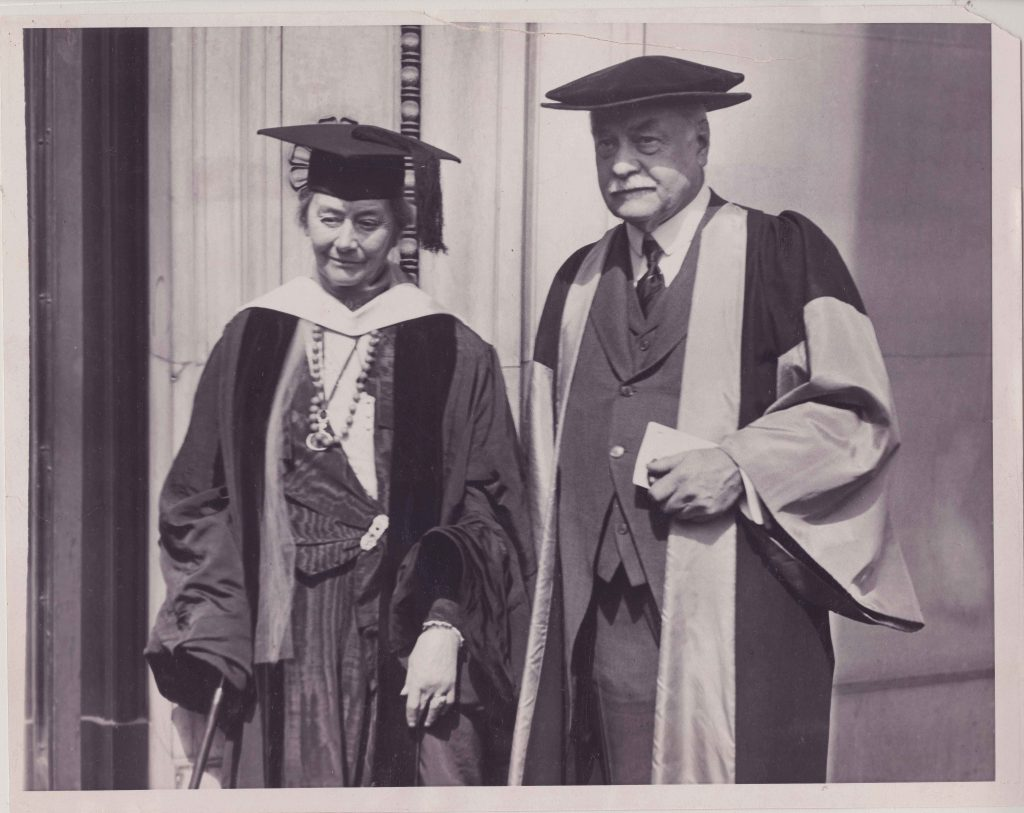 woman and man in graduation caps and gowns