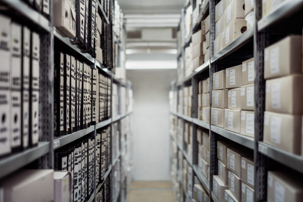 rows of archival boxes in a white room
