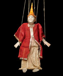 puppet on strings with conical hat and read and gold trimmed robe
