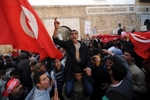 (FILES) A photo taken on January 23, 2011 shows inhabitants of the central Tunisia region of Sidi Bouzid demonstrating in front of the Government palace in Tunis as they came from a poverty-stricken rural region where the crackdown against a wave of social protests in the final days of ousted president Zine El Abidine Ben Ali's 23-year regime was at its harshest. Tunisian mediators of the socalled National Dialogue Quartet (Tunisian General Labour Union UGTT, Tunisian Confederation of Industry, Trade and Handicrafts UTICA, Tunisian Human Rights League LTDH and Tunisian Order of Lawyers) won the 2015 Nobel Peace Prize, for helping to create the only democracy to emerge from the Arab Spring, at a time when the country is under threat from Islamist violence, the Norwegian Nobel Commitee announced on October 9, 2015 .