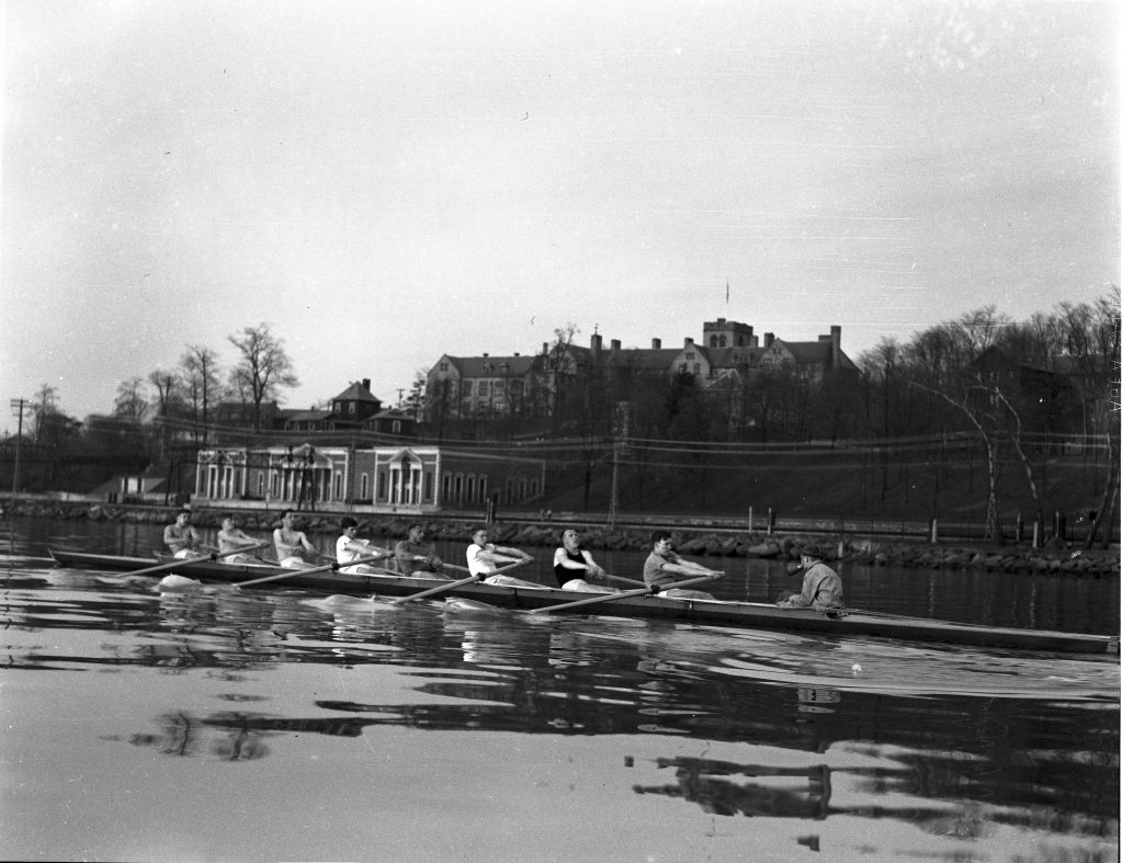1935 crew team rowing on the river.