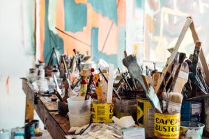 table of paint brushes and paints